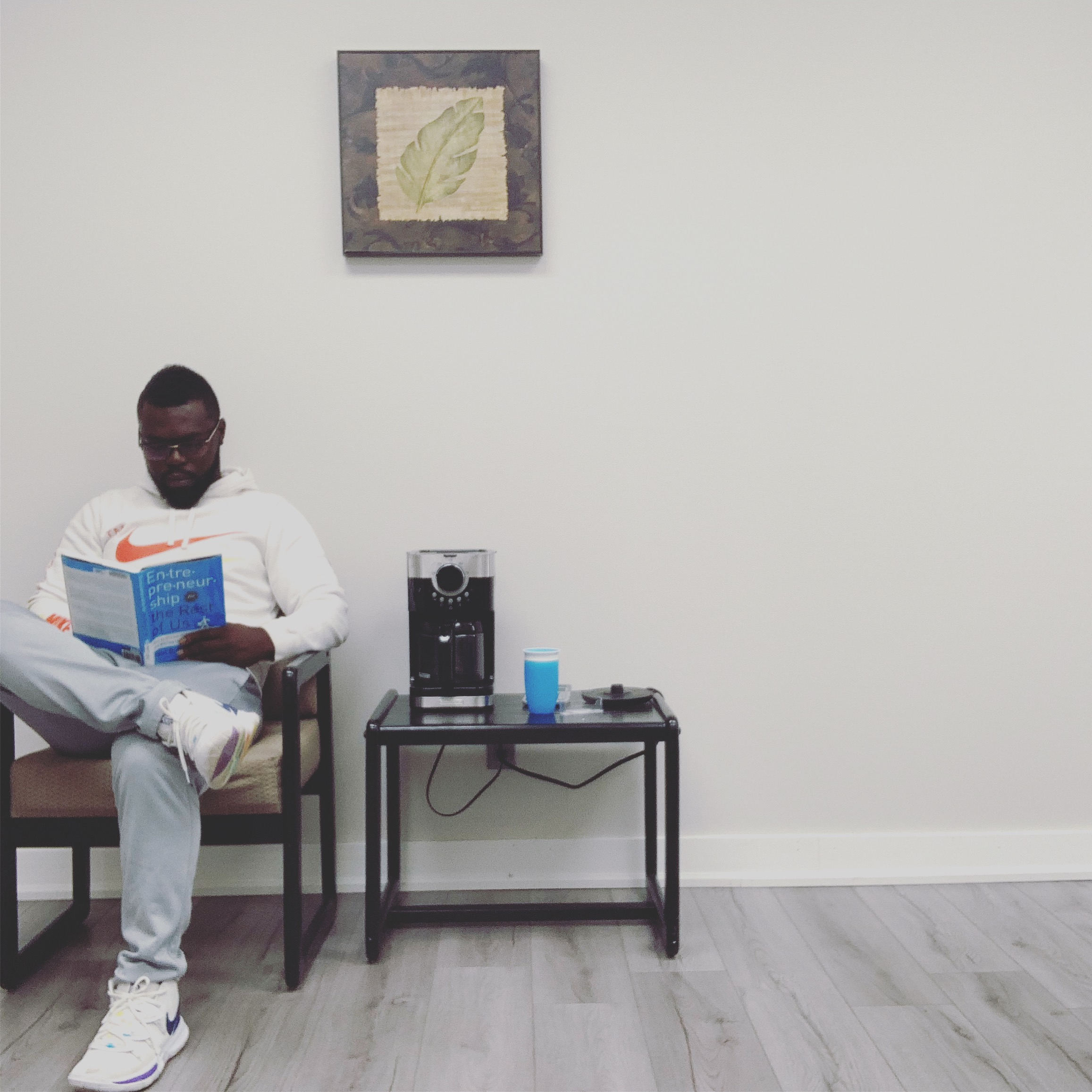 a picture of Emmanuel Appiah reading a book about entrepreneurship